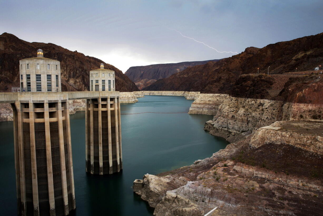 In this July 28, 2014, file photo, lightning strikes over Lake Mead near Hoover Dam that impounds Colorado River water at the Lake Mead National Recreation Area in Arizona. Lawmakers in Congress have introduced a bill that would pump tens of billions of dollars into fixing and upgrading the country's dams. The bill, introduced by Democratic U.S. Rep.