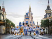 This undated photo provided by Walt Disney World shows Disney characters at Walt Disney World in Lake Buena Vista, Fla. Walt Disney World is planning an 18-month celebration in honor of its 50th anniversary, starting in October 2021.