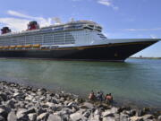 The Disney Dream sails out of Port Canaveral, Fla. on a two night test sailing, also known as a simulation cruise, Saturday, July 17, 2021. The cruise included about 300 Disney cruise employees and their guests. This is the first cruise activity out of Port Canaveral since March of 2020 when cruising was shut down due to COVID-19.