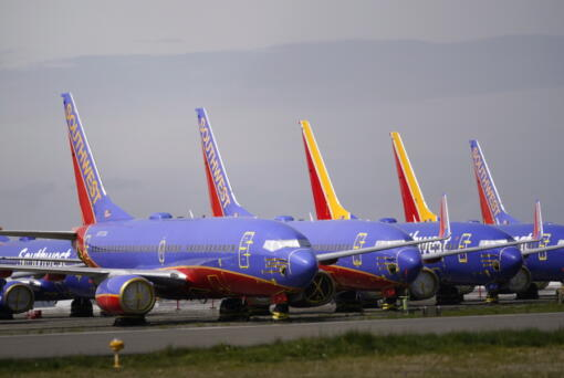 A line of Southwest Air Boeing 737 jets are parked near the company's production plant while being stored at Paine Field Friday, April 23, 2021, in Everett, Wash. Boeing reported its first quarterly profit since 2019 and revenue topped expectations, as the giant aircraft maker tries to dig out from the most difficult stretch in its history. Boeing said Wednesday, July 28, 2021, that it earned $567 million in the second quarter, compared with a $2.4 billion loss a year ago.