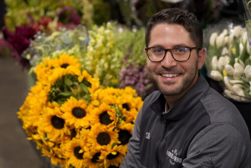 Steven Dyme, owner of Flowers for Dreams, poses for a portrait at his warehouse Friday, July 23, 2021, in Chicago. Dyme says the $15 minimum made it much easier to staff up when the economy reopened this spring and demand for flowers, particularly for weddings, soared. The company has four locations, including its headquarters in Chicago, one in Milwaukee, and two in Detroit.