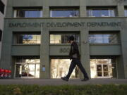 FILE - In this Dec. 18, 2020, file photo, a person passes the office of the California Employment Development Department in Sacramento, Calif. The recession that broke out with onset of the coronavirus pandemic officially ended in April 2021, making it the shortest downturn on record, according to the committee of economists that determines when recessions begin and end.