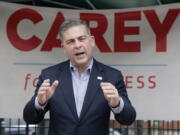 In this June 1, 2021 photo, Mike Carey, speaks at the kick-off of his 15th Congressional District campaign in Grove City, Ohio. Former President Donald Trump has backed Carey, a longtime coal lobbyist, as one of the candidates in the crowded Republican primary for an open U.S. House seat in central Ohio. (Barbara J.