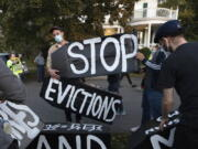 FILE - In this Oct. 14, 2020, file photo, housing activists erect a sign in Swampscott, Mass. A federal freeze on most evictions is set to expire soon. The moratorium, put in place by the Centers for Disease Control and Prevention in September, was the only tool keeping millions of tenants in their homes.