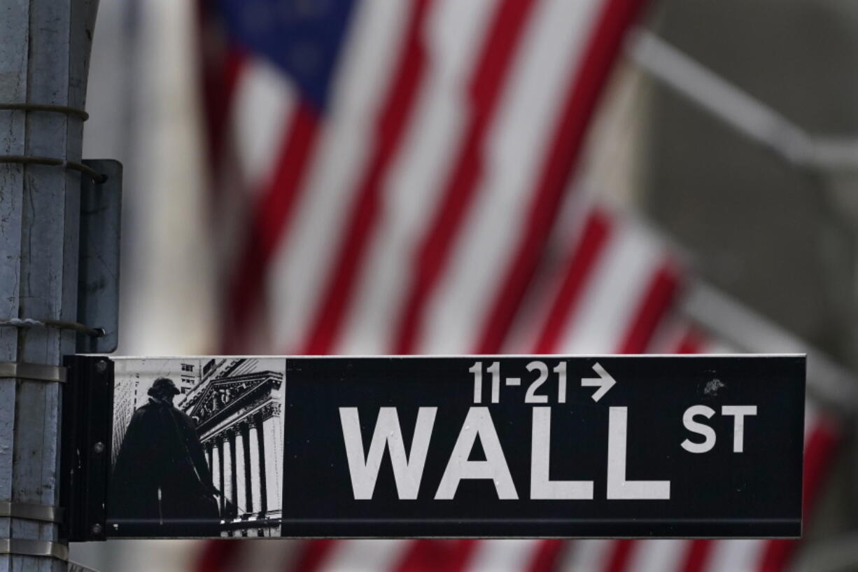 FILE - In this Nov. 23, 2020 file photo, a street sign is displayed at the New York Stock Exchange in New York. Stocks are off to a sluggish start on Wall Street as investors look over a surprise increase in claims for unemployment benefits and mixed news on corporate earnings. The S&P 500 was wavering between small gains and losses in the first few minutes of trading Thursday, July 22, 2021.
