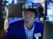 Specialist Michael Gagliano works at his post on the trading floor of the New York Stock Exchange, Tuesday, July 20, 2021. Stocks are opening higher on Wall Street Tuesday as investors shake off a rout a day earlier brought on by concerns about the spread of a more contagious variant of COVID-19.