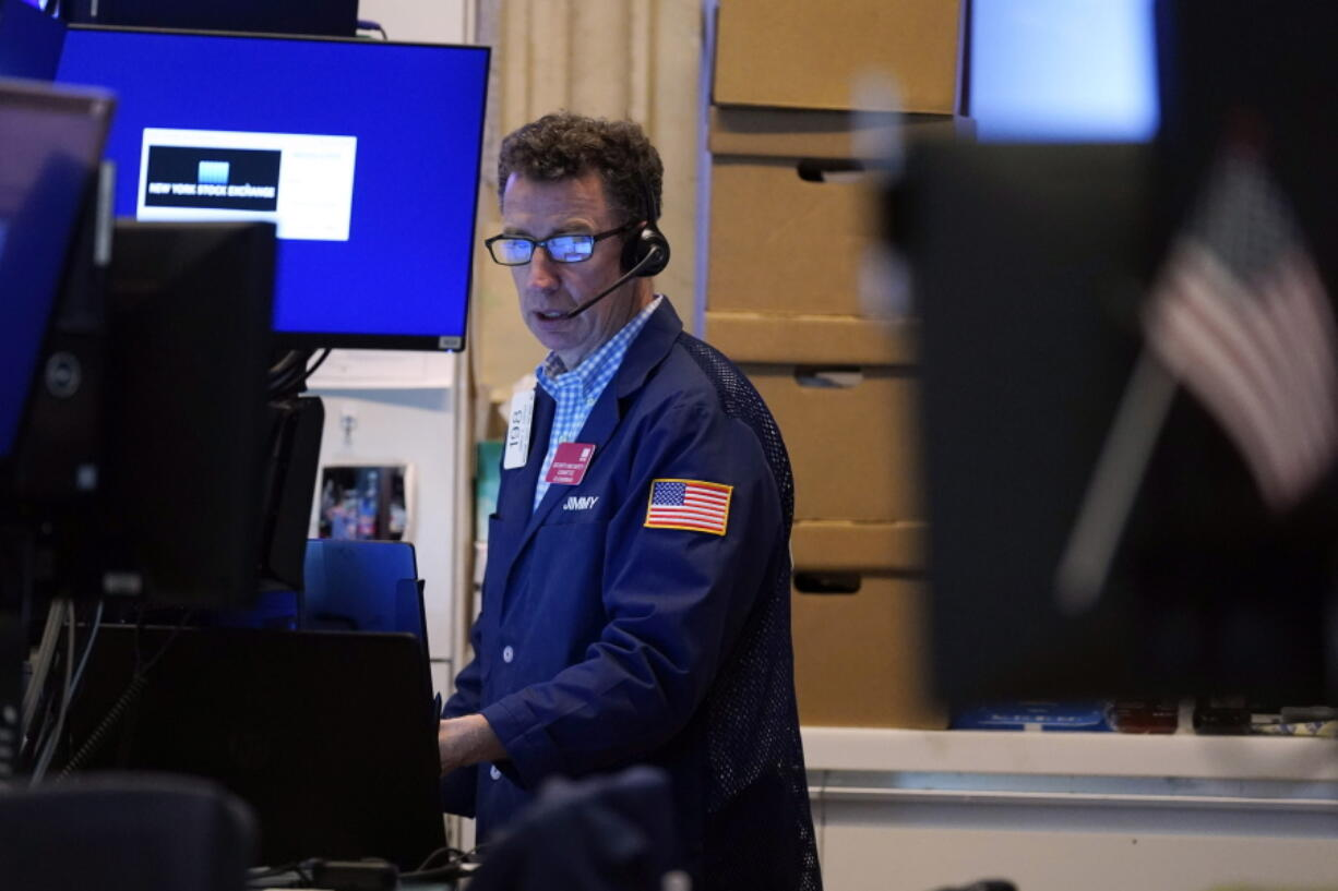 A trader works in his booth on the floor of the New York Stock Exchange, Monday, July 12, 2021. Stocks are opening broadly lower on Wall Street, echoing losses overseas, as investors become more worried about a resurgence in global infections of COVID-19. The benchmark S&P 500 was down 1.2% in the early going Monday, July 19 and Treasury yields moved lower as investors moved money into U.S. government bonds.