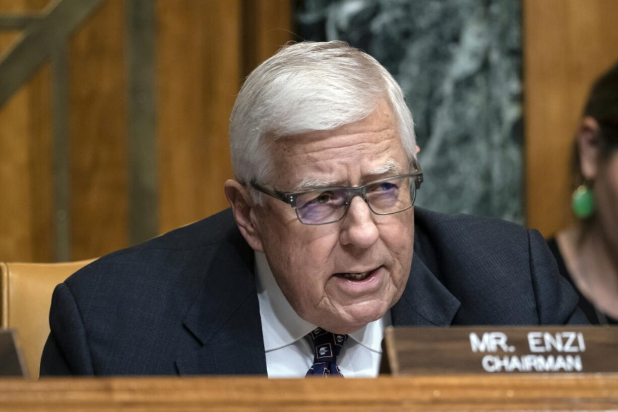 FILE - In this March 27, 2019, file photo, Sen. Mike Enzi, R-Wyo., chairman of the Senate Budget Committee, makes an opening statement on the fiscal year 2020 budget resolution, on Capitol Hill in Washington. Recently retired U.S. Sen. Mike Enzi of Wyoming died Monday, July 26, 2021. He was 77 years old. (AP Photo/J.