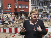 German Chancellor Angela Merkel speaks at a press conference in Muenstereifel, Germany, Tuesday, July 20, 2021. Merkel and North Rhine-Westphalia's Prime Minister Laschet visited Bad Muenstereifel, which was badly affected by the storm.