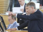 Bjoern Hoecke, parliamentary group leader of the AfD in the Thuringian state parliament, speaks before the vote in the plenary hall in Erfurt, Germany, July 23, 2021.  The far-right Alternative for Germany party failed in an attempt Friday to unseat the left-wing governor of an eastern German state, a long-shot bid that opponents denounced as political theater.