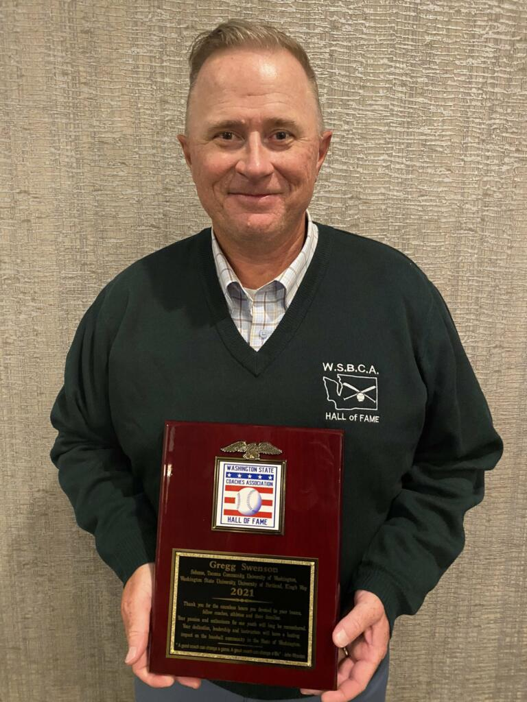 Former King's Way Christian coach Gregg Swenson poses with his hall-of-fame plaque after being inducted into the Washington State Baseball Coaches Association Hall of Fame (Photo courtesy of Gregg Swenson)