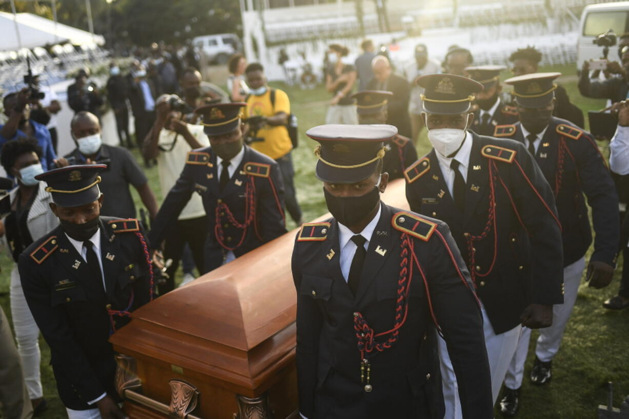Police carry the coffin of slain Haitian President Jovenel Moise at the start of the funeral at his family home in Cap-Haitien, Haiti, early Friday, July 23, 2021. Moise was assassinated at his home in Port-au-Prince on July 7.