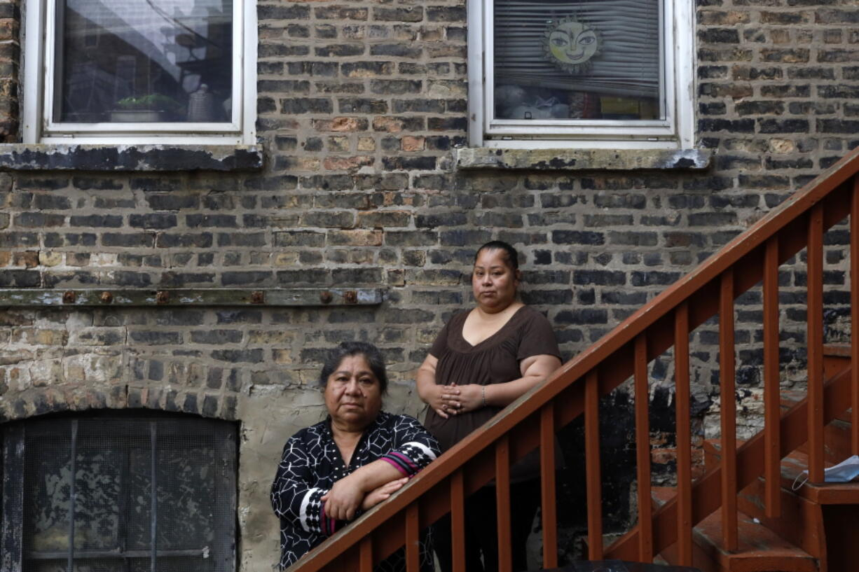 Maria Elena Estamilla, 62, left, and her daughter, Esmeralda Triquiz, pose for a photo last month in Chicago's Pilsen neighborhood. Estamilla's last full medical exam was in 2015; she sees no options for care as an immigrant without legal permission to live in the U.S.