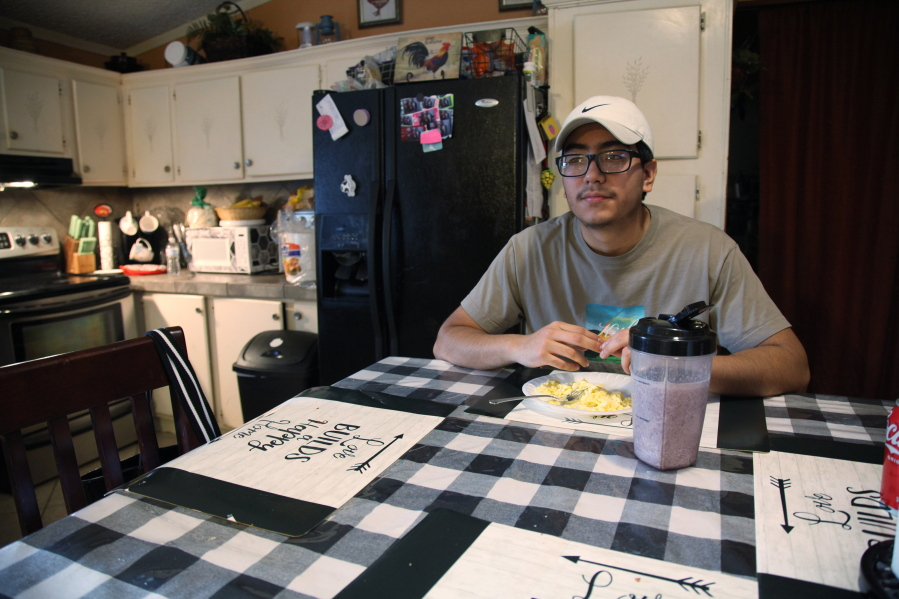 Samuel Alfaro, pauses between responses during an interview at his home in Houston, Texas, Friday, July 23, 2021. Alfaro said his appointment to help obtain deferred action for childhood arrival or DACA immigration status was canceled due to a recent federal court ruling against the program. (AP Photo/John L.
