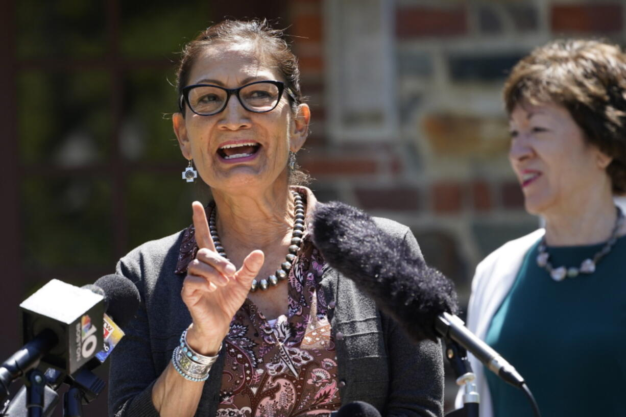 FILE-In this June 18, 2021 file photo, Interior Secretary Deb Haaland speaks to reporters during a visit to Acadia National Park in Winter Harbor, Maine.  Haaland is visiting her home state this weekend, Saturday, July 17, to celebrate what marks the largest wilderness land donation in the agency's history. The donation from the Trust for Public Land increases the size of the Sabinoso Wilderness in northeastern New Mexico by nearly 50%. (AP Photo/Robert F.