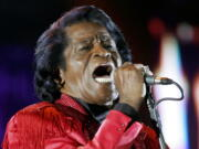 FILE - In this July 6, 2005 file photo, James Brown performs on stage during the Live 8 concert at Murrayfield Stadium in Edinburgh, Scotland. The family of entertainer James Brown has reached a settlement ending a 15-year battle over late singer's estate. David Black, an attorney representing Brown's estate, confirmed to The Associated Press on Friday, July 23, 2021 that the agreement was reached July 9.