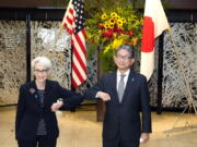 U.S. Deputy Secretary of State Wendy Sherman, left, elbow bumps with Japanese Vice-Minister for Foreign Affairs Takeo Mori, right, prior to their meeting at the Iikura Guesthouse Tuesday, July 20, 2021, in Tokyo.