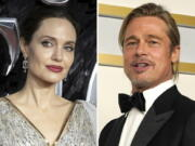 """In this combination photo, Angelina Jolie, left, arrives at the European Premiere of """"Maleficent Mistress of Evil"""" in central London on Oct. 9, 2019, and Brad Pitt poses in the press room at the Oscars on April 25, 2021, in Los Angeles. A California appeals court on Friday, July 23, 2021, disqualified a private judge being used by Angelina Jolie and Brad Pitt in their divorce case, handing Jolie a major victory. The 2nd District Court of Appeal agreed with Jolie that Judge John Ouderkirk didn't sufficiently disclose business relationships with Pitt's attorneys. The decision means that the custody fight over the couple's five minor children, which was nearing an end, could be starting over."""