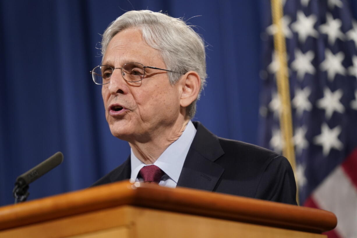 FILE - In this June 25, 2021 file photo, Attorney General Merrick Garland speaks during a news conference at the Department of Justice in Washington. The Justice Department is launching gun strike forces in five cities in the U.S. It is part of an effort to reduce spiking violent crime by addressing illegal trafficking and prosecuting offenses that help put guns in the hands of criminals.