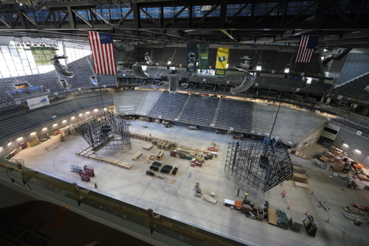 The ice and seating areas of Climate Pledge Arena are viewed during a media tour of the facility, Monday, July 12, 2021, in Seattle. The arena will be the home of the NHL hockey team Seattle Kraken and the WNBA Seattle Storm basketball team as well as hosting concerts and other performing arts events. (AP Photo/Ted S.