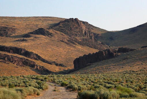 The Montana Mountains loom over Thacker Pass in northern Nevada, July 14, 2021. A federal judge on Friday, July 23, has denied environmentalists' request for a court order temporarily blocking the government from digging trenches for archaeological surveys at a mine planned near the Nevada-Oregon line with the biggest known U.S. deposit of lithium.