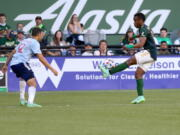 Portland Timbers forward Jeremy Ebobisse, right, balances the ball on his foot during an MLS match against FC Dallas, Saturday, July 17, 2021.