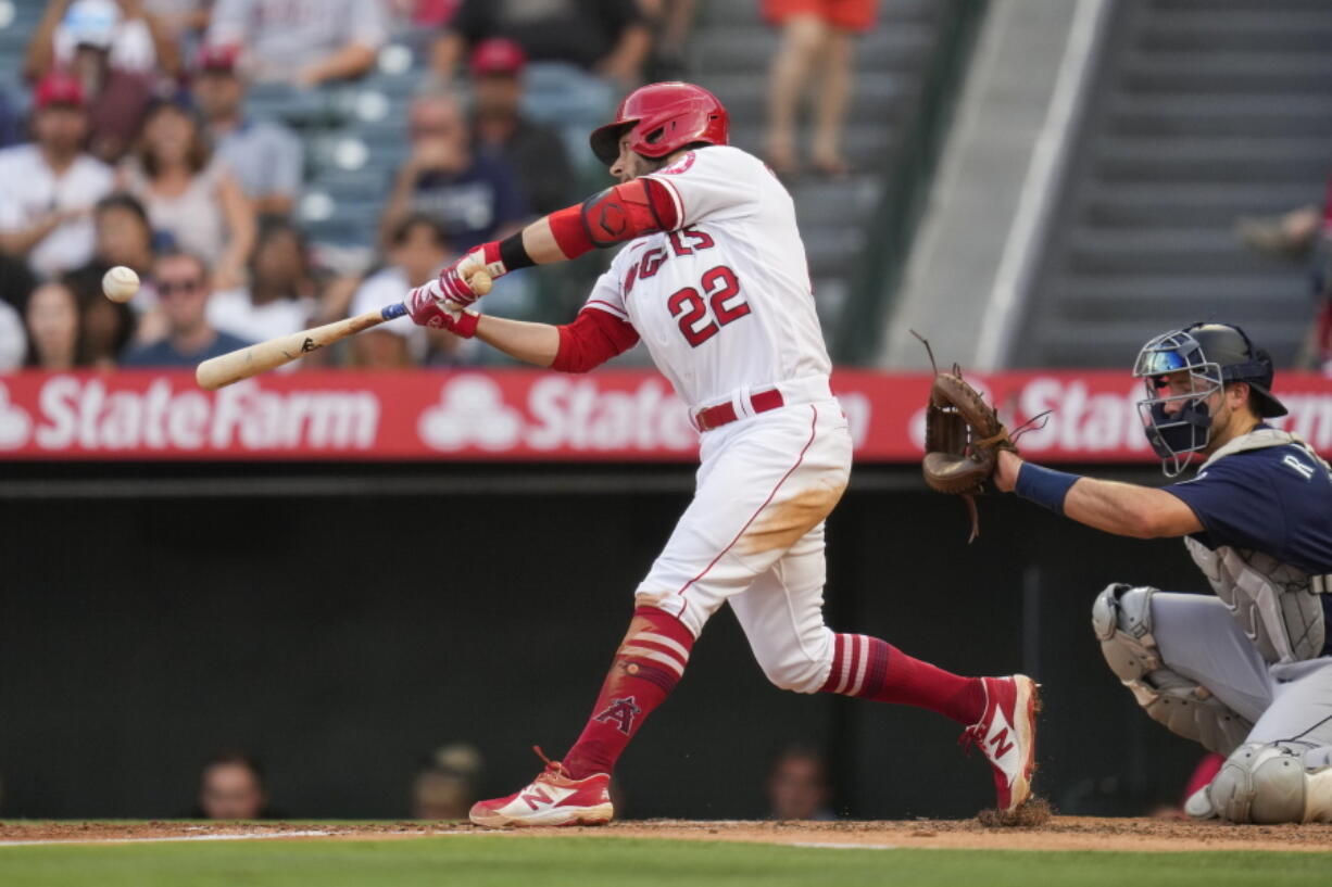 Los Angeles Angels' David Fletcher (22) doubles during the second inning of a baseball game against the Seattle Mariners Saturday, July 17, 2021, in Anaheim, Calif. Taylor Ward, Juan Lagares, and Jack Mayfield scored.