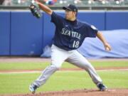 Seattle Mariners starting pitcher Yusei Kikuchi throws to the Toronto Blue Jays during the first inning. (Jeffrey T.