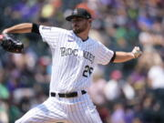 Colorado Rockies starting pitcher Austin Gomber works against the Seattle Mariners in the first inning of a baseball game Wednesday, July 21, 2021, in Denver.