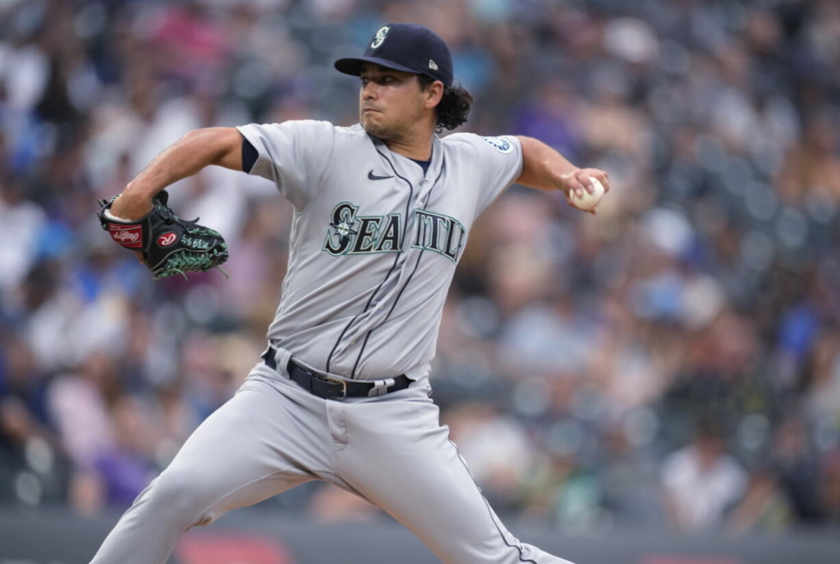 Seattle Mariners starting pitcher Marco Gonzales works against the Colorado Rockies during the first inning of a baseball game Tuesday, July 20, 2021, in Denver.