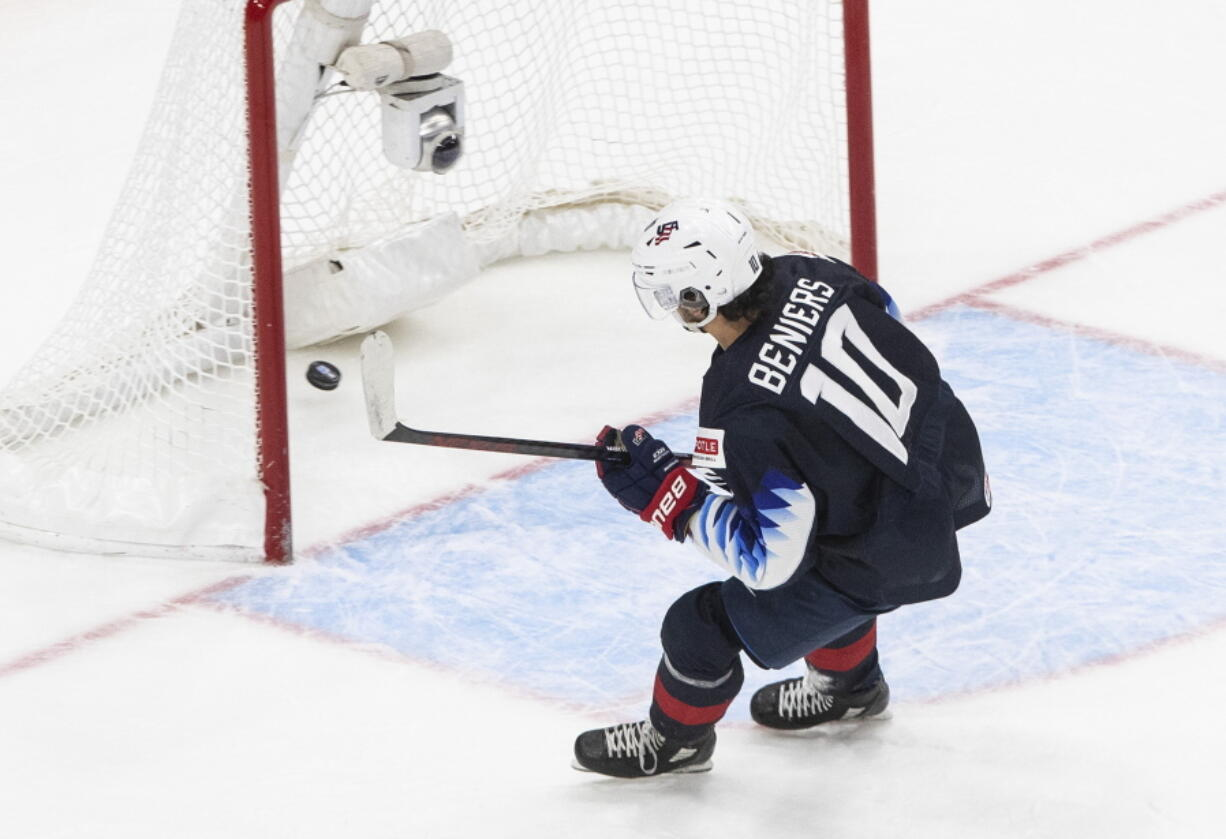 Playing for the United States, Matthew Beniers (10) scores an empty net goal against Slovakia during the World Junior Hockey championship game in Jan. 2, 2021. He became the Seattle Kraken's first-ever draft pick, going No. 2 overall on Friday, July 23, 2021.