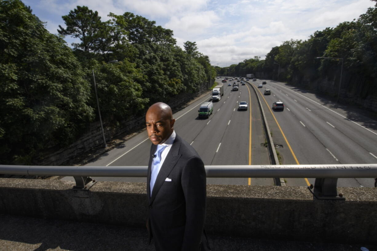 Tennessee State Rep. Harold Love, Jr. stands on an overpass over I-40, Monday, July, 19, 2021, near the site of his family's former home on the north side of Nashville, Tenn. Love Jr.'s father, a Nashville city councilman, was forced to sell his home near here to make way for the highway, but put up a fight in the 1960s against the rerouting of Interstate 40 because he believed it would stifle and isolate Nashville's Black community. Love Jr. is now part of a group pushing to build a cap across the highway, behind him, that creates a community space to help reunify the city.