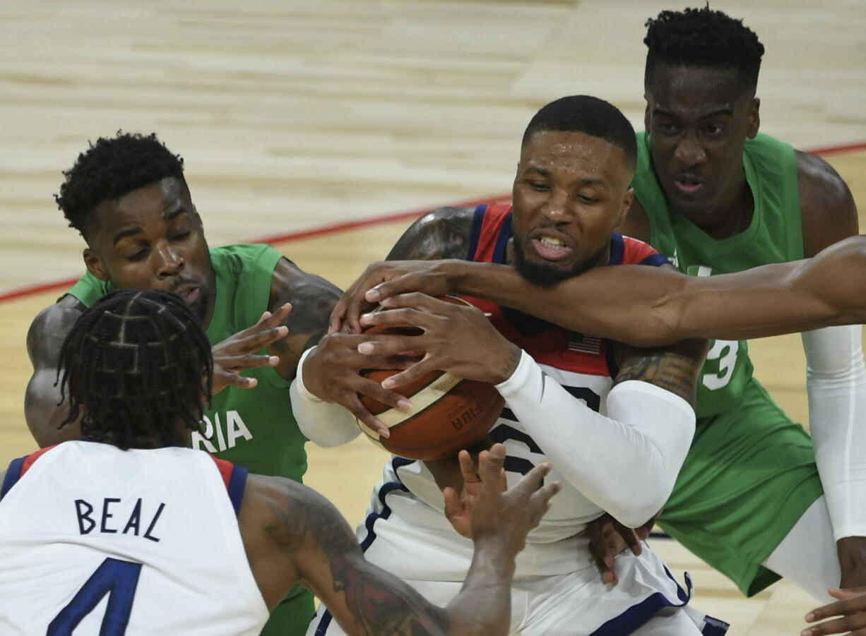 United States' Damian Lillard (6) defends the ball against Nigeria during an exhibition basketball game Saturday, July 10, 2021, in Las Vegas.