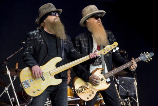 FILE - Dusty Hill, left, and Billy Gibbons from U.S rock band ZZ Top perform at the Glastonbury music festival in Somerset, England, June 24, 2016. ZZ Top has announced that Hill, one of the Texas blues trio's bearded figures and bassist, has died at his Houston home. He was 72. In a Facebook post, bandmates Billy Gibbons and Frank Beard revealed Wednesday, July 29, 2021, that Hill had died in his sleep.