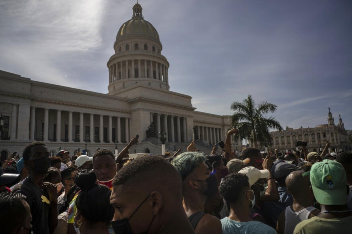 FILE - In this July 11, 2021 file photo, people protest in front of the Capitol in Havana, Cuba. A report released Wednesday, July 21,  shows philanthropic funding to promote global human rights reached a record $3.7 billion in 2018. The report by the philanthropy research organization Candid and Human Rights Funders Network says nearly half of the donations came from 12 foundations and most of the contributions were earmarked for programs in North America.