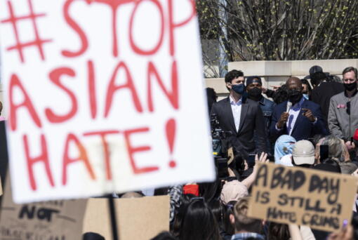 """FILE - This March 20, 2021, file photo shows, U.S. Sens. Jon Ossoff, D-Ga., and Raphael Warnock, D-Ga., speaking during a """"stop Asian hate"""" rally outside the Georgia State Capitol in Atlanta.  A national coalition of civil rights groups will release on Wednesday, July 28, 2021, a comprehensive, state-by-state review of hate crime laws in the United States. Members of the coalition say the report sets the stage for bolstering the efficacy of current law and addresses racial disparities in how the laws are enforced."""