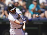 Seattle Mariners' Luis Torrens connects for a three-run home run against the Texas Rangers in the fourth inning of a baseball game Sunday, July 4, 2021, in Seattle.
