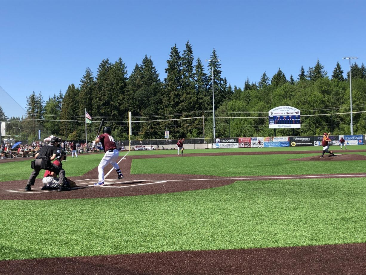 Ridgefield Raptors first baseman Dominic Enbody awaits a pitch from Corvallis right-hander Brock Townsend on Sunday at Ridgefield Outdoor Recreation Complex.