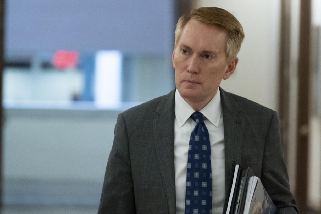 FILE - Sen. James Lankford, R-Okla., arrives for a hearing on Capitol Hill, Tuesday, June 8, 2021, in Washington. Lankford,  whose voting record in the Senate has aligned with former President Donald Trump's position nearly 90% of the time, finds himself under fierce attack by a challenger in his own party. Similar scenes are playing out in other red states where ultra right-wing challengers are tapping into anger among Republicans over Trump's election loss and coronavirus-related lockdowns.