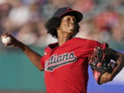 Cleveland Indians starting pitcher Triston McKenzie delivers in the first inning of a baseball game against the Kansas City Royals, Friday, July 9, 2021, in Cleveland.