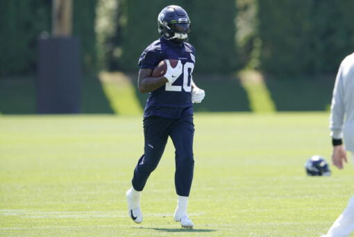 Seattle Seahawks running back Rashaad Penny carries the ball during NFL football practice Thursday, July 29, 2021, in Renton, Wash. (AP Photo/Ted S. Warren) (Ted S.