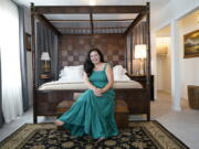 """Heather Bise, owner of The House of Bise Bespoke, poses in the """"Art"""" bedroom, Monday, July 19, 2021, in Cleveland. Small businesses in the U.S. that depend on tourism and vacationers say business is bouncing back, as people re-book postponed trips and take advantage of loosening restrictions, a positive sign for the businesses that have struggled for more than a year. Bise started in 2019 and catered to international tourists, attracting guests from New Zealand, Botswana, Eastern Europe and elsewhere."""