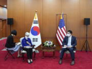 In this photo provided by South Korea Foreign Ministry, U.S. Deputy Secretary of State Wendy Sherman, second from left, talks to journalists as South Korean First Vice Foreign Minister Choi Jong Kun listens after their meeting at the Foreign Ministry in Seoul, South Korea, Friday, July 23, 2021. America's No. 2 diplomat on Friday expressed sympathy for North Koreans facing hardships and food shortages linked to the pandemic, and renewed calls for the North to return to talks over its nuclear program.