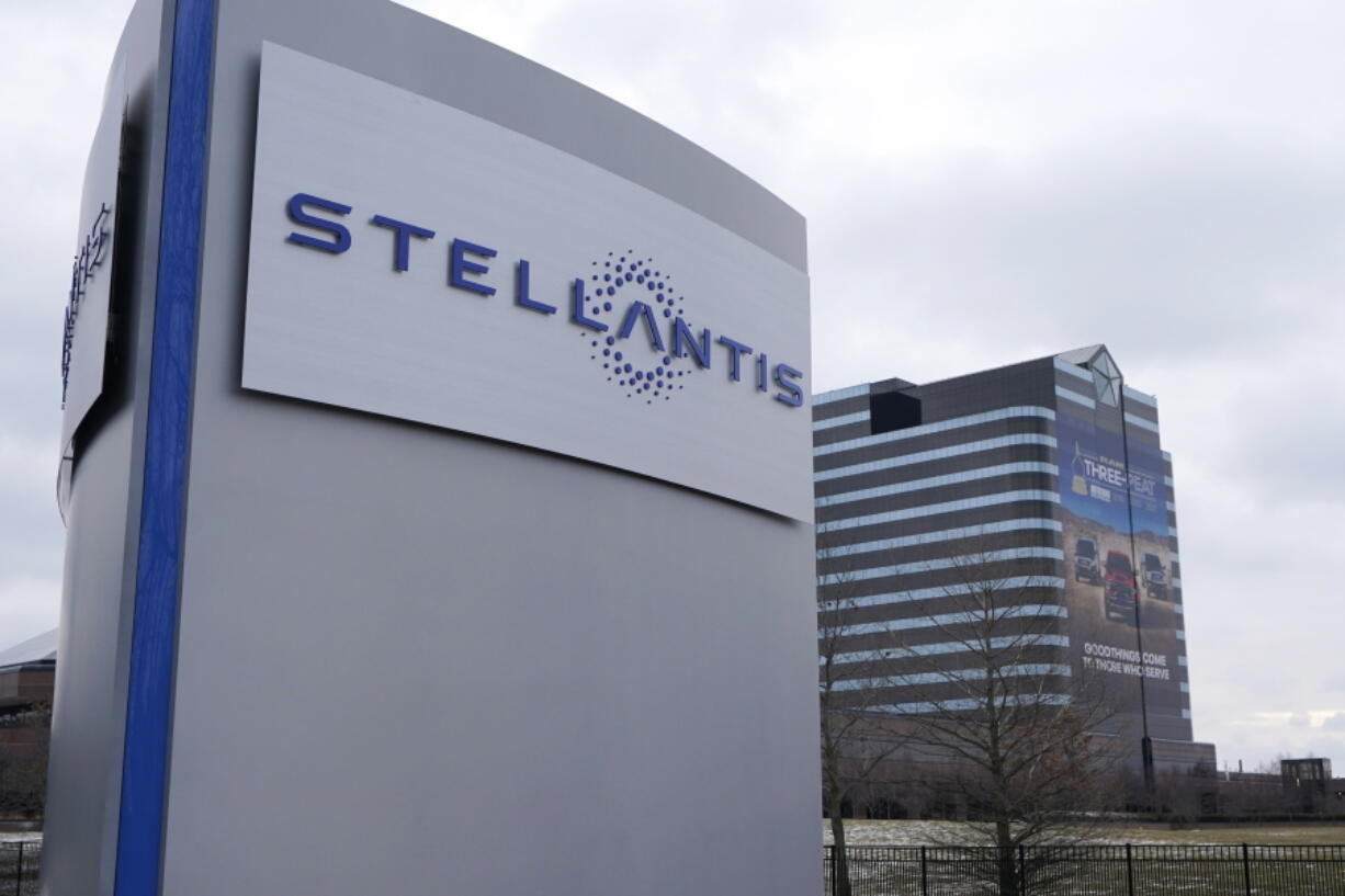 FILE - In this file photo taken on Jan. 19, 2021, the Stellantis sign is seen outside the Chrysler Technology Center in Auburn Hills, Mich.  The leader of the world's fourth-largest automaker expects a global computer chip shortage that has cut vehicle production to last into next year. Stellantis CEO Carlos Tavares says, Wednesday, July 21, 2021, the shortage will easily drag into 2022.