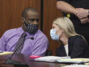Defendant Nathaniel Rowland speaks with his attorney, Alicia Goode, right, during his trial in Richland County Court, Tuesday, July 20, 2021, in Columbia, S.C. Rowland is on trial for the kidnapping and murder of 21-year-old Samantha Josephson.