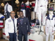 Olympic medalists in fencing, Peter Westbrook, left, and Daryl Homer model the Team USA Tokyo Olympic opening ceremony uniforms at the Ralph Lauren SoHo store on Wednesday, July 7, 2021, in New York.