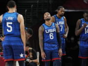 United States' Damian Lillard (6), Kevin Durant (7), and Draymond Green (16) their loss to France in wait for play to resume during their loss to France in a men's basketball preliminary round game at the 2020 Summer Olympics, Sunday, July 25, 2021, in Saitama, Japan.