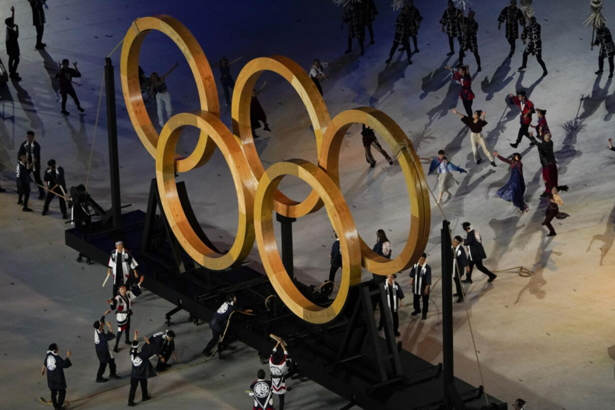 Actors perform during the opening ceremony at the Olympic Stadium at the 2020 Summer Olympics, Friday, July 23, 2021, in Tokyo.