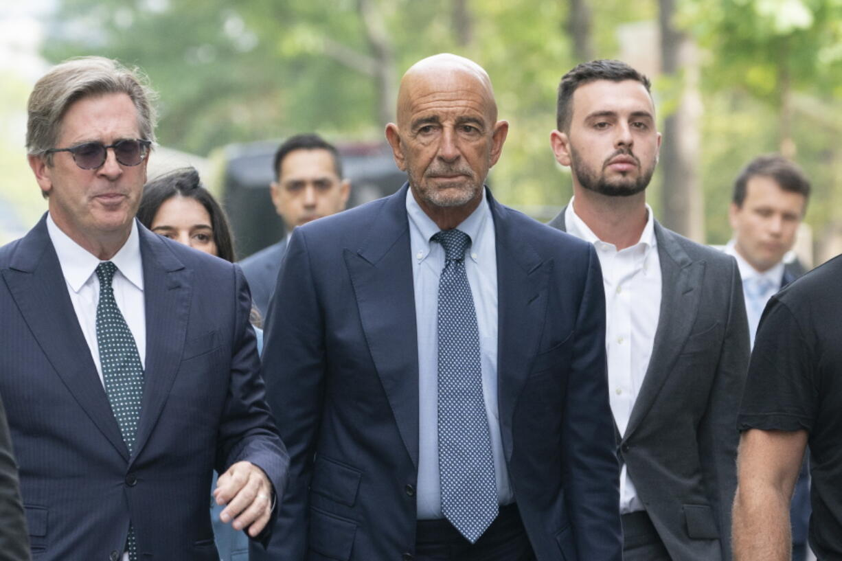 Tom Barrack, center, arrives at Brooklyn federal court, Monday, July 26, 2021, in New York. Barrack was among three men charged in New York federal court with trying to influence foreign policy while Donald Trump was running in 2016 and later while president. The chair of former President Donald Trump's 2017 inaugural committee allegedly conspired to influence U.S. policy to benefit the United Arab Emirates, even while he was seeking a position as an American diplomat.