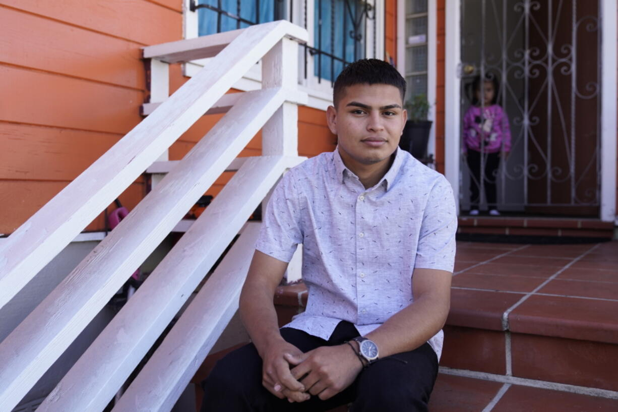 Alan Reyes Picado poses outside his home, as his niece looks on from behind, in San Francisco, California, Friday, July 9, 2021. Reyes arrived in the United States in Feb. 2021, after receiving death threats in Nicaragua and is asking for asylum.